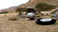 Camping site. Kettle, bonfire, mountains 1. Stock Footage
