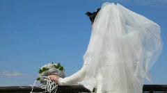 Bride on observation deck against sky Stock Footage