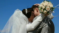 Hugging bride and bridegroom kissing outdoor Stock Footage