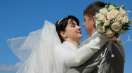 Stock Video Footage of bridegroom and bride kissing outdoor