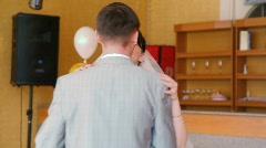 Bride and bridegroom slow dancing indoor Stock Footage
