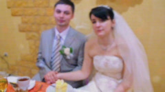 bridegroom and bride sits at wedding table and rocks - stock footage