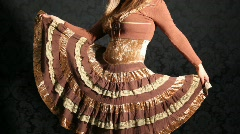 Girl dressed in skirt with frills dancing Stock Footage