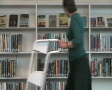 Librarian walks past Stock Footage