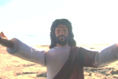 Toy Jesus and Tidal Wave - stock footage