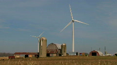 Farm buildings with windturbine on harvested fields in fall Stock Footage
