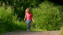 little girl exercising in summer forest - stock footage