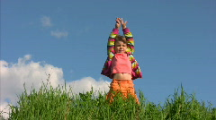 Girl in meadow exercising yoga Stock Footage