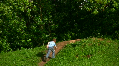 Boy and girl walking up to hill Stock Footage