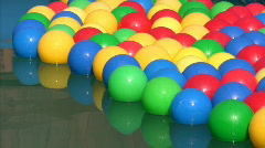 Balls floating in inflatable swimming pool Stock Footage