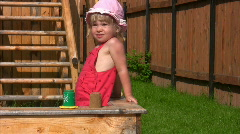 Little girl playing with sand mould in sandbox Stock Footage