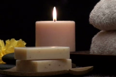 Zen Spa scene with massage rocks and candles V2 - NTSC - stock footage