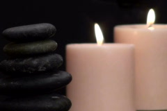Zen Spa scene with massage rocks and candles V4 - NTSC Stock Footage