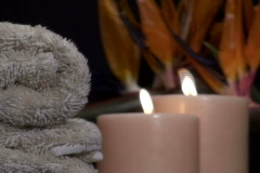 Zen Spa scene with flowers and candles V1- NTSC Stock Footage
