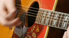 Struming a Guitar Stock Footage