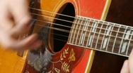 Struming a Guitar Stock Footage