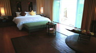 Stock Video Footage of HOTEL RESORT BEDROOM SUITE DOLLY