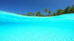Tropical island split shot lagoon and beach Stock Footage
