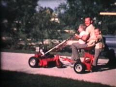 Kids On Riding Lawn Mower (1967 Vintage 8mm film) Stock Footage