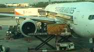 Stock Video Footage of SINGAPORE-PLANE-UNLOADING 1