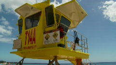 Lifeguard hut, pan to beach Stock Footage