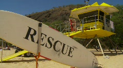 Lifeguard hut and surfboard Stock Footage