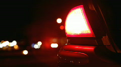 Tail light flashing on side of road - stock footage