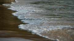 Small wave on sand Stock Footage