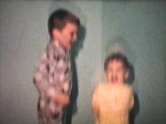 Kids Jumping On Bed (1968 Vintage 8mm film) - stock footage