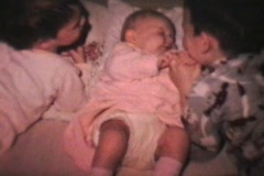 Boy Cuddles Baby Sister (1968 Vintage 8mm film) Stock Footage