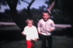 Brother And Sister Play Outside (1968 Vintage 8mm film) Stock Footage