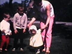 Family In Front Yard (1968 Vintage 8mm film) - stock footage