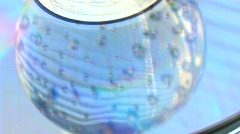 Glass ball on a light surface Stock Footage