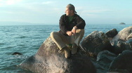 Man at coastline of Baikal lake Stock Footage