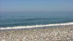 Summer landscape, rocky coast and sea surf Stock Footage