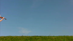 young woman plays violin and walks on hill - stock footage