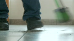 Man cleans the Floor - stock footage