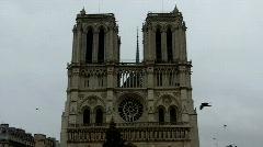 Notre Dame de Paris facade with birds Stock Footage