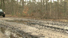 Four-wheel drive wades through muddy water Stock Footage