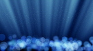 Blue loopable background round lights and flying particles Stock Footage