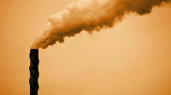 Smoke Stack Causing Air Pollution Against a Dirty Brown Sky - Smokestack - stock footage