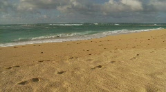 Footprints in the sand, beach and big waves Stock Footage