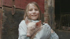 Girl holding piglet - stock footage