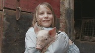 Stock Video Footage of Girl holding piglet