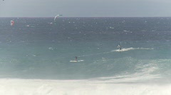 Fitness, kite surfers on huge waves Stock Footage