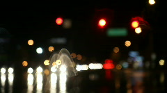 Rainy night traffic at intersection Stock Footage