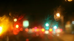 Changing lanes on a rainy night Stock Footage