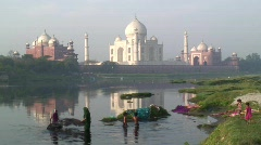 Women washing Saris in the river by Taj Mahal, Agra, India - stock footage