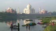 Women washing Saris in the river by Taj Mahal, Agra, India Stock Footage