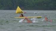 Swimmers Racing In Triathlon Stock Footage